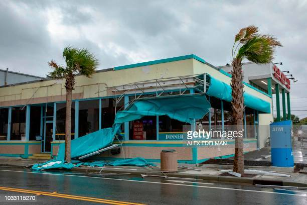 TOPSHOT Storm damage caused by high winds is seen on Ocean Avenue as the outer bands of Hurricane Florence make landfall on September 14 2018 in...