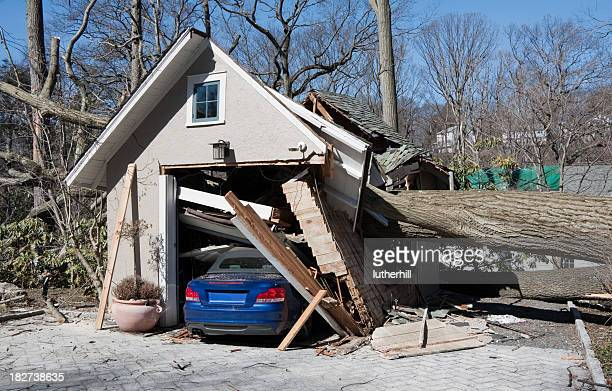 storm damage from tree onto a garage and car