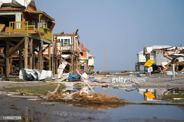 Storm damaged houses after Hurricane Ida on September 3, 2021 in Grand Isle, Louisiana. Ida made landfall as a Category 4 hurricane five days before...