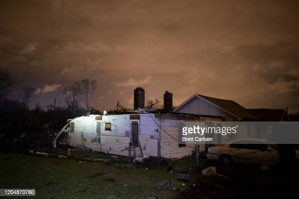 Storm damaged houses stand in portion on Underwood St on March 3 2020 in Nashville Tennessee A tornado passed through Nashville just after midnight...