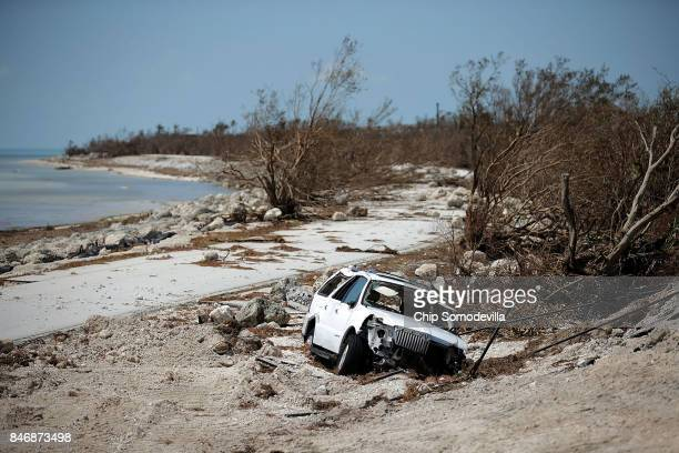 A storm damaged truck sits mired in the sand close to where Hurricane Irma washed out the two northbound lanes of Highway 1 September 13 2017 in...