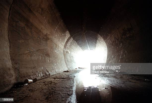Storm drain in one of many that empty water, pollution, and litter into the Los Angeles River, November in Los Angeles, CA. Engineers began...