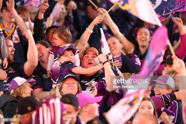 Storm fans celebrate a try during the 2017 NRL Grand Final match between the Melbourne Storm and the North Queensland Cowboys at ANZ Stadium on...
