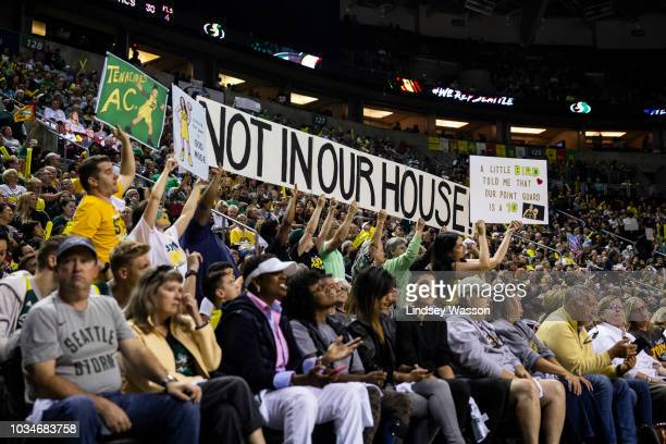 Storm fans hold up a 'not in our house' sign during the first half of Game 2 of the WNBA Finals at KeyArena against the Washington Mystics on...
