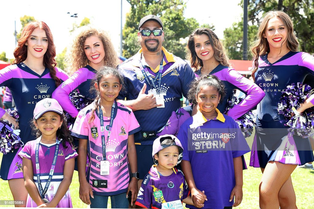 Storm fans pose for a portrait with cheerleaders during the Melbourne Storm Family Day on February 3, 2018 in Melbourne, Australia.