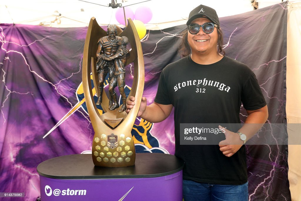 Storm fans pose for a portrait with the NRL trophy during the Melbourne Storm Family Day on February 3, 2018 in Melbourne, Australia.