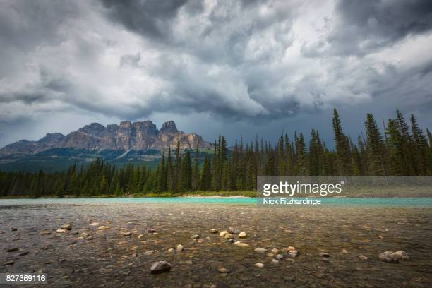 A storm generates behind Castle Mountain and the Bow River, banff National Park, Alberta, Canada