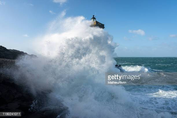 storm in bretagne with huge waves in le conquet - littoral photos et images de collection