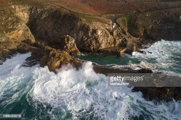 storm in pointe du raz and bestrée harbor - littoral photos et images de collection