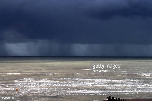 Storm in summer at Sussex beach uk in July with heavy rain and stormy clouds ahead