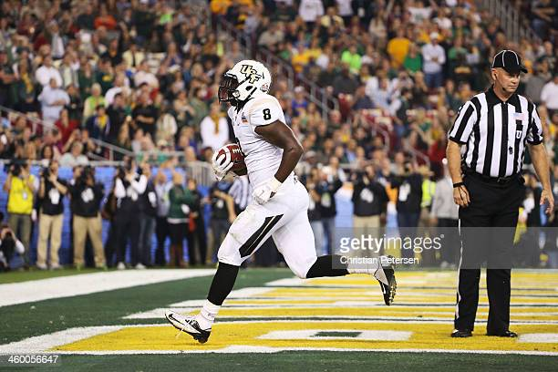 Storm Johnson of the UCF Knights runs for a first quarter touchdown against the Baylor Bears during the Tostitos Fiesta Bowl at University of Phoenix...