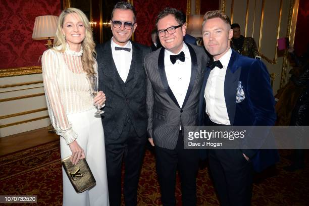 Storm Keating, Paul Drayton, Alan Carr and Ronan Keating attend the Julien Macdonald Fashion Show for National Osteoporosis Society at Lancaster...