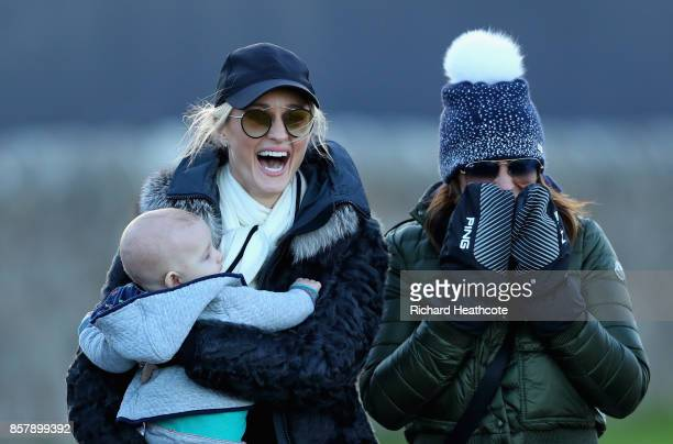 Storm Keating stands with her son Cooper Keating and Helen Storey during day one of the 2017 Alfred Dunhill Championship at The Old Course on October...