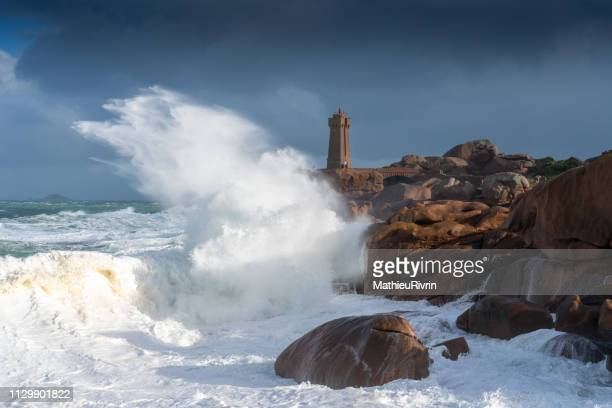 "storm martin in ploumanach and the amazing ""cote de granite rose"" - cotes d'armor stock photos and pictures"