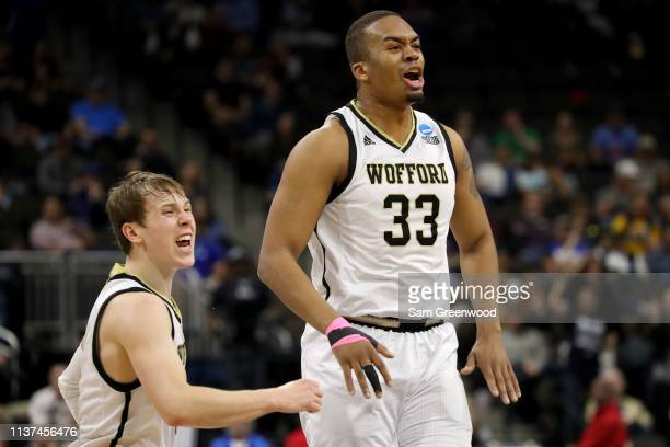 Storm Murphy and Cameron Jackson of the Wofford Terriers celebrate in the first half against the Seton Hall Pirates during the first round of the...