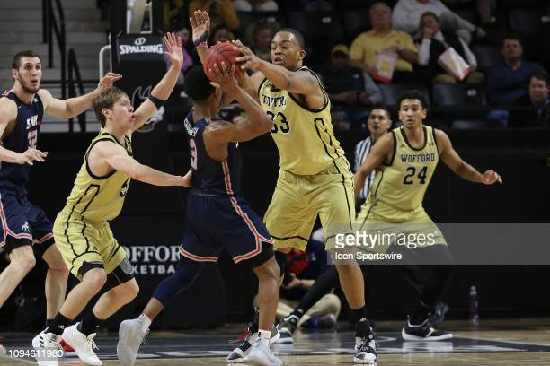 Storm Murphy guard of Wofford and Cameron Jackson forward of Wofford defend Josh Sharkey guard for Samford during college basketball game between the...
