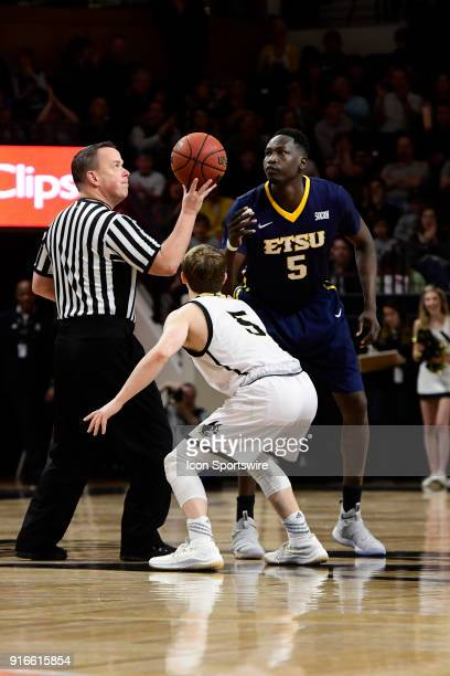Storm Murphy guard Wofford College Terriers at 5foot 11inches jumps against 7foot Peter Jurkin center East Tennessee State University Buccaneers to...
