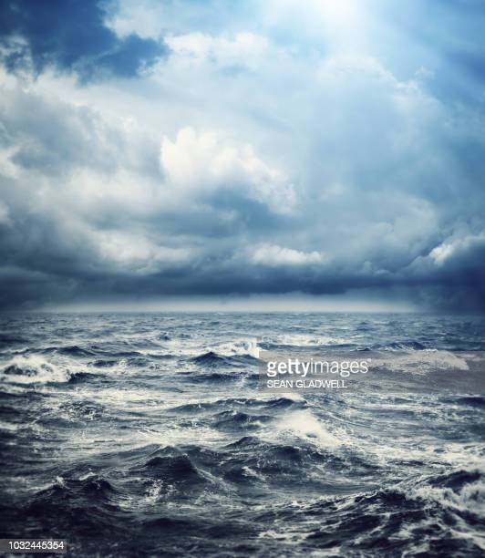 storm ocean - dramatic sky stock pictures, royalty-free photos & images