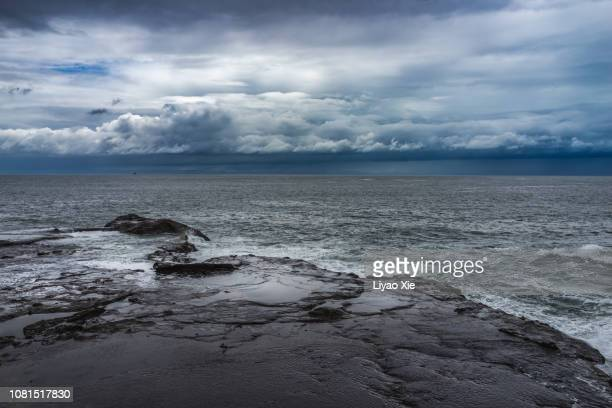 storm on the coastline - liyao xie stock pictures, royalty-free photos & images