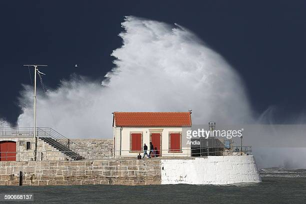 Storm on the marigraph and the dyke of Socoa in Ciboure in the bay of SaintJeandeLuz in the Basque Country