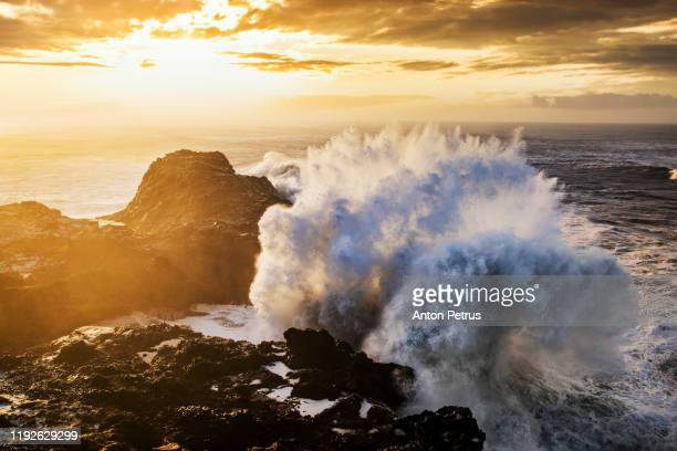 storm on the sea with dramatic clouds at sunset - rock formation stock pictures, royalty-free photos & images