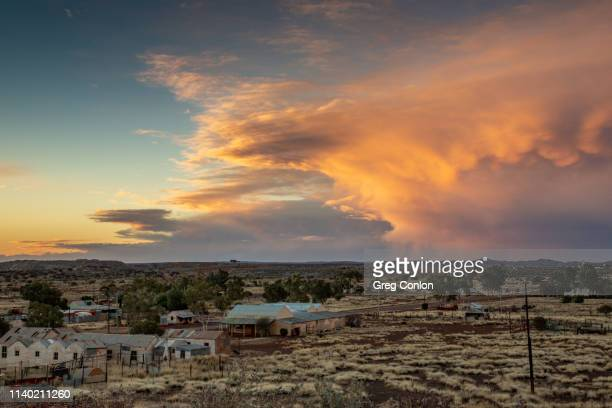 storm over australian outback ghost town at sunset - town stock pictures, royalty-free photos & images
