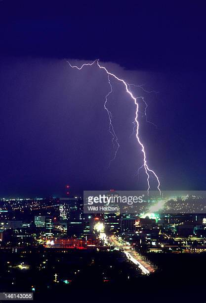 Storm over downtown Tucson with two cloudtoground lightning strike points Tucson Arizona USA