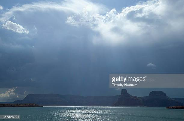 storm over rock formations and lake - timothy hearsum stock pictures, royalty-free photos & images