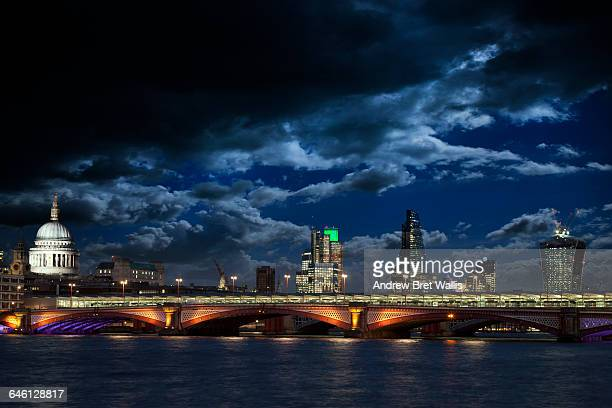 Storm over the city of London at dusk.