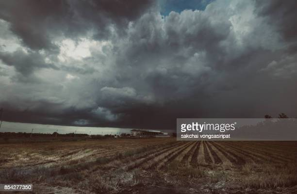 storm over the farm - ominous stock photos and pictures