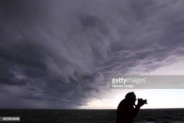 A storm passes by as an amateur photographer captures gigantic waves crashing into Mornington Harbour on July 31 2014 in Melbourne Australia...