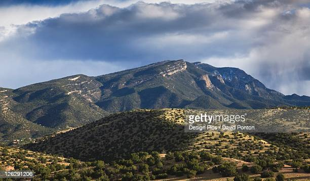 storm passes over the sandia mountains, viewed from placitas - sandia mountains stock photos and pictures