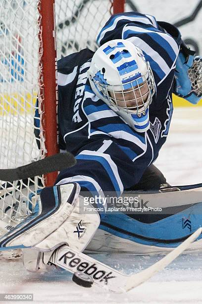Storm Phaneuf of the Chicoutimi Sagueneens pokes the puck away with his stick again the Gatineau Olympiques on February 20, 2015 at Robert Guertin...