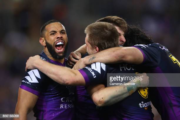 Storm players celebrate a try during the 2017 NRL Grand Final match between the Melbourne Storm and the North Queensland Cowboys at ANZ Stadium on...
