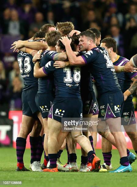 Storm players celebrate a win during the NRL Preliminary Final match between the Melbourne Storm and the Cronulla Sharks at AAMI Park on September 21...