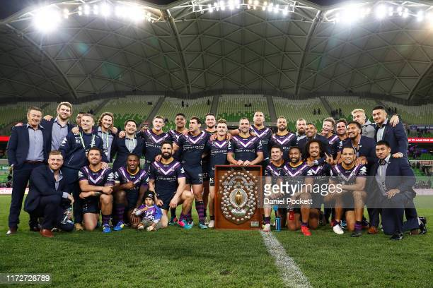 Storm players celebrate after winning the J. J. Giltinan Shield for finishing on top of the ladder after the home and away season during the round 25...