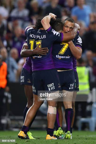 Storm players celebrate winning the 2017 NRL Grand Final match between the Melbourne Storm and the North Queensland Cowboys at ANZ Stadium on October...