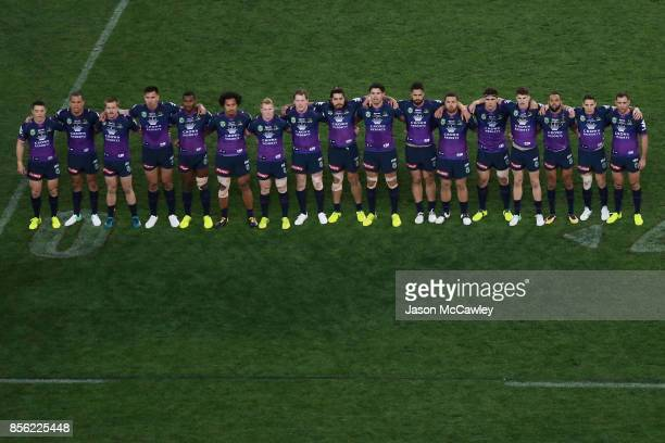 Storm players line up during the 2017 NRL Grand Final match between the Melbourne Storm and the North Queensland Cowboys at ANZ Stadium on October 1...