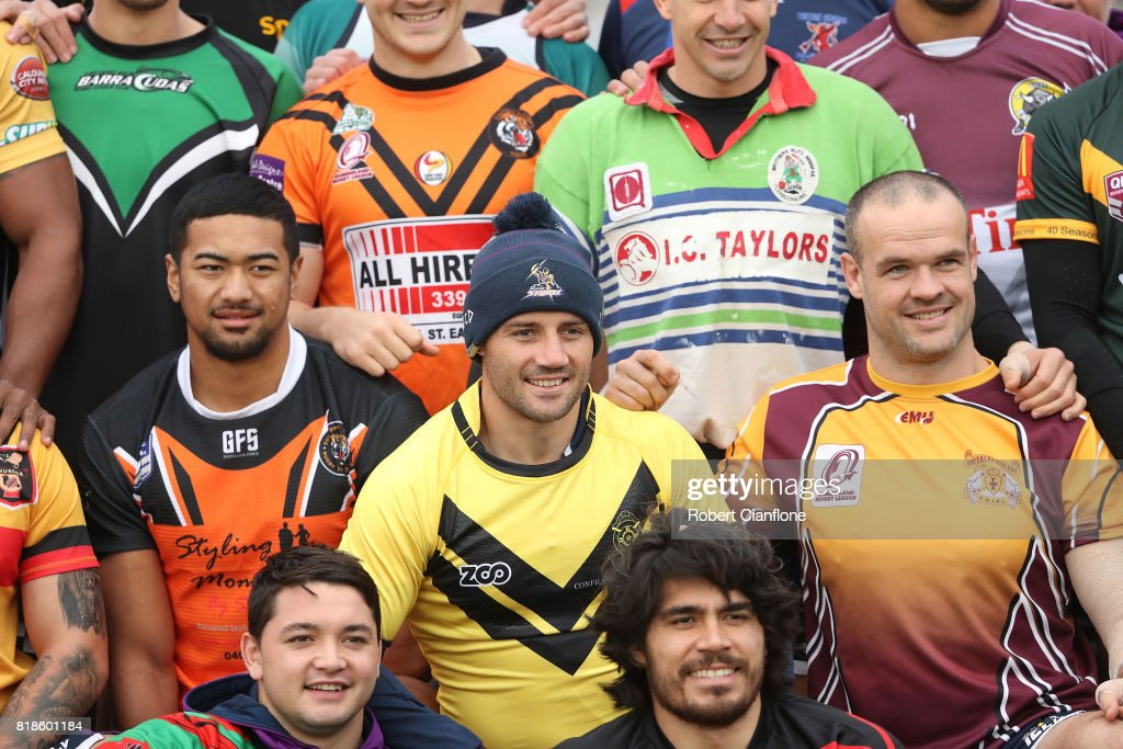 Storm players pose for a team photo as they wear their junior club jerseys during a Melbourne Storm NRL training session at Gosch's Paddock on July 19, 2017 in Melbourne, Australia.