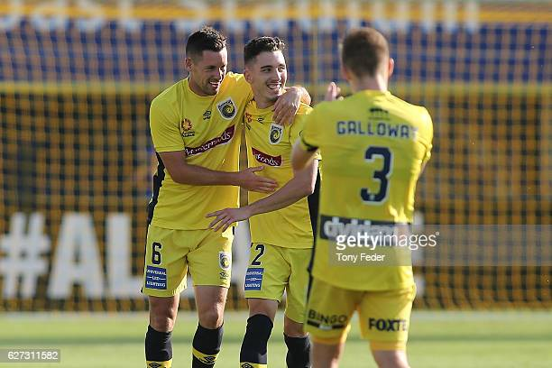 Storm Roux and Blake Powell of the Mariners celebrate a goal during the round nine A-League match between Central Coast Mariners and the Western...