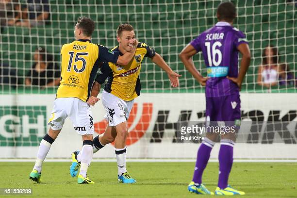 Storm Roux and Mitchell Duke of the Mariners celebrate a goal during the round seven A-League match between Perth Glory and the Central Coast...
