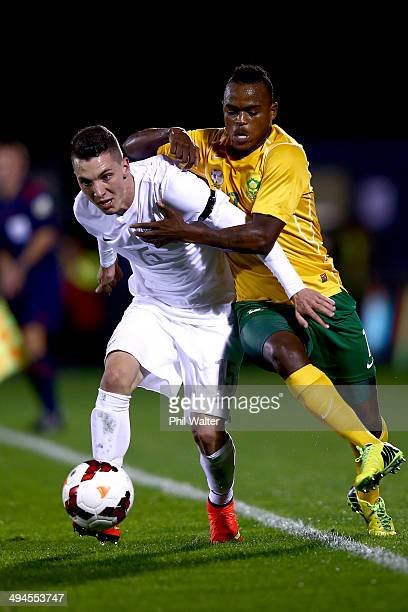 Storm Roux of New Zealand is held back by Ayanda Patosi of South Africa during the International Friendly match between the New Zealand All Whites...