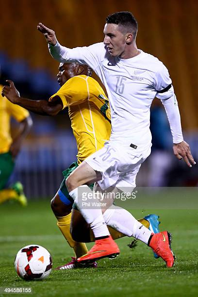 Storm Roux of New Zealand is tackled by Tokelo Rantie of South Africa during the International Friendly match between the New Zealand All Whites and...