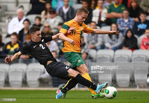 Storm Roux of the Junior All Whites tackles Connor Pain of the Young Socceroos during the Under 20 International friendly match between the...