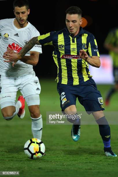 Storm Roux of the Mariners competes for the ball during the round 21 ALeague match between the Central Coast Mariners and the Wellington Phoenix at...