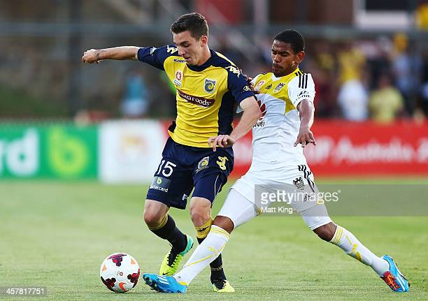 Storm Roux of the Mariners competes with Kenny Cunningham of the Phoenix during the round six ALeague match between the Central Coast Mariners and...