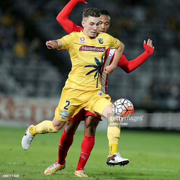 Storm Roux of the Mariners contests the ball against Harry Novillo of Melbourne City during the round nine A-League match between the Central Coast...