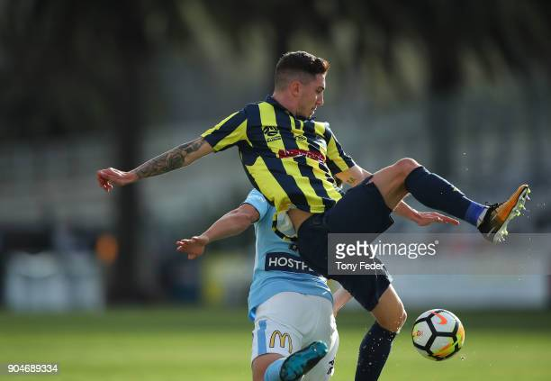 Storm Roux of the Mariners contests the ball during the round 16 ALeague match between the Central Coast Mariners and Melbourne City at Central Coast...