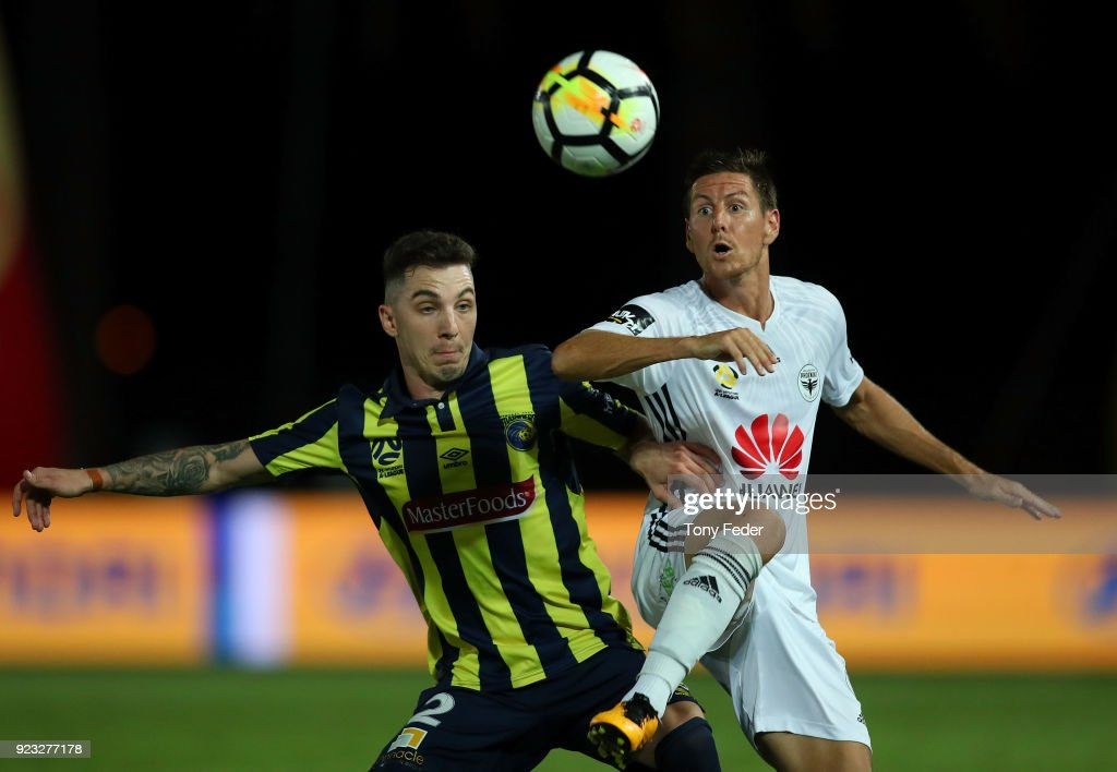 Storm Roux of the Mariners contests the ball with Nathan Burns of the Phoenix during the round 21 A-League match between the Central Coast Mariners and the Wellington Phoenix at Central Coast Stadium on February 23, 2018 in Gosford, Australia.