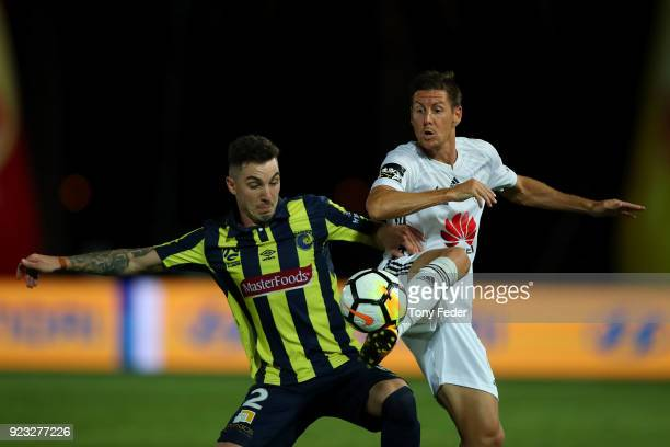 Storm Roux of the Mariners contests the ball with Nathan Burns of the Phoenix during the round 21 ALeague match between the Central Coast Mariners...